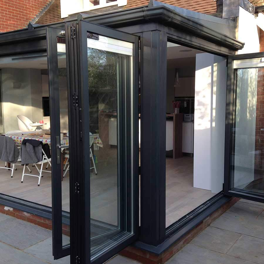 glass extension with bi fold doors