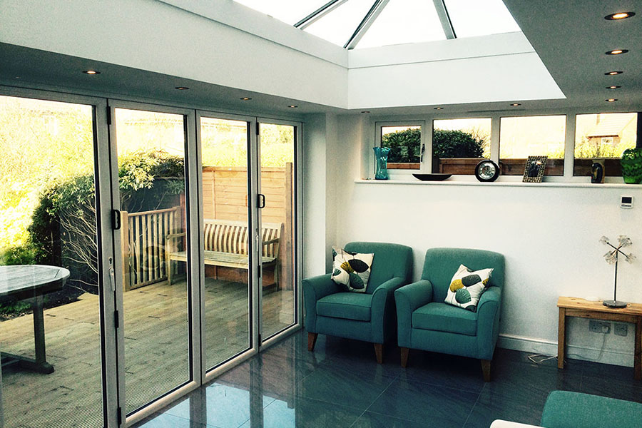 inside orangery house extension in Kent with Bi Fold Doors