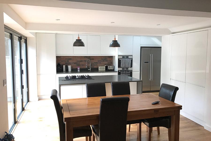 white kitchen extension bi-fold doors